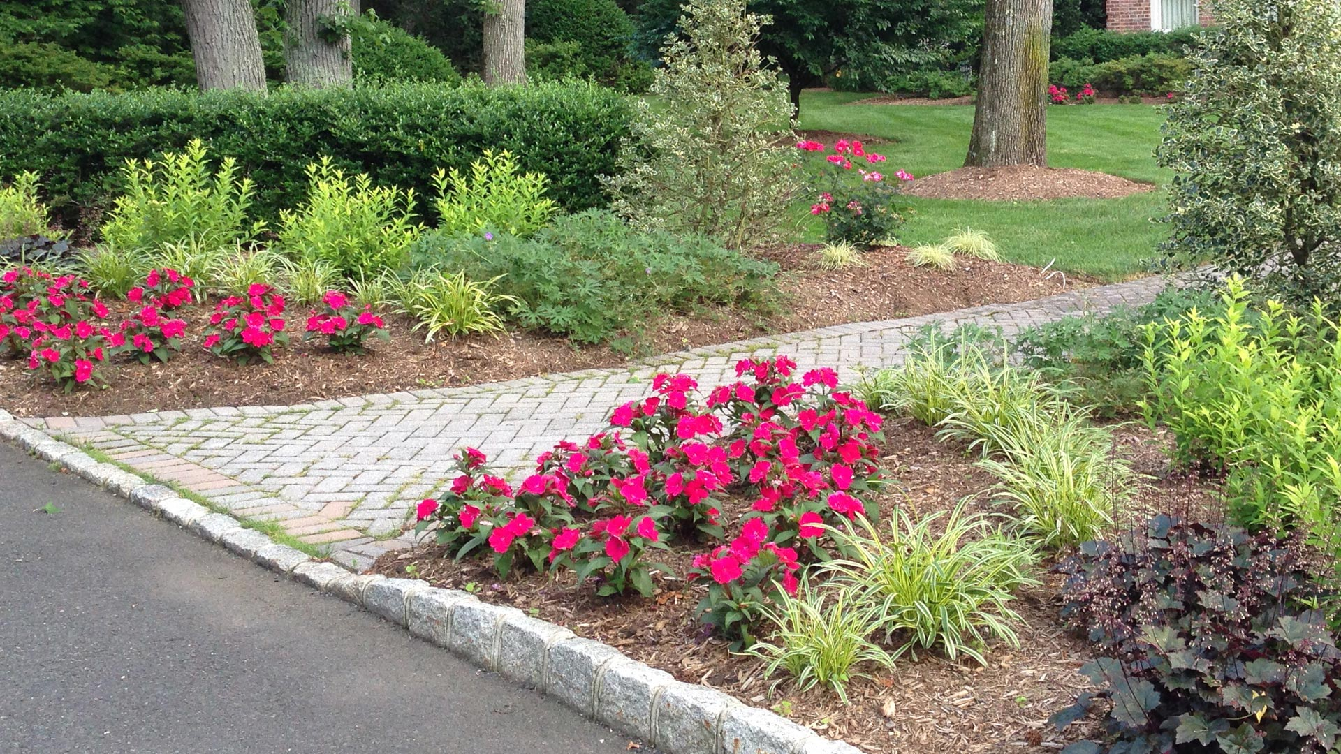 Professionally maintained landscape design at a residential property in Watchung.
