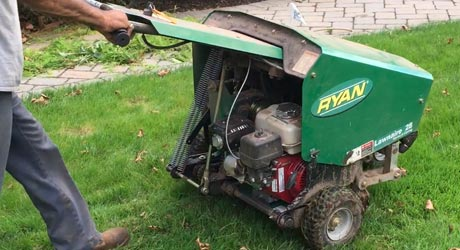 Aerating the front lawn in preparation for overseeding.